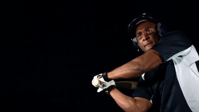 Baseball player hits ball, slow motion