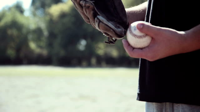 Baseball Player Tossing Ball into Glove video