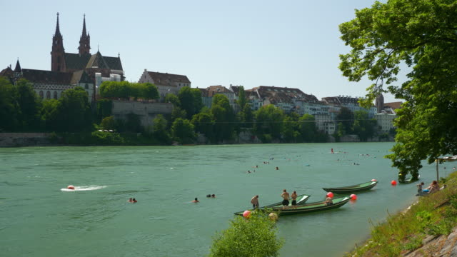 basel city sunny day riverside crowded swimming area boat parking bay view slow motion panorama 4k switzerland