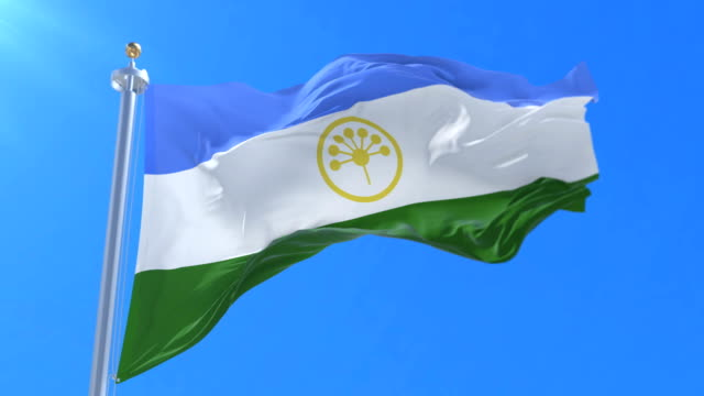 bashkortostan flag waving at wind in slow with blue sky, loop - monti urali video stock e b–roll