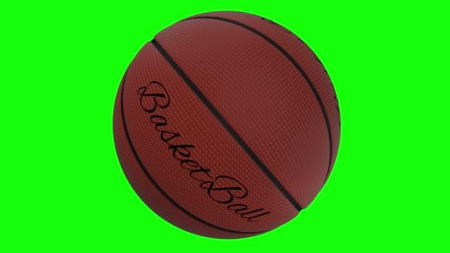 basketball med orden basket roterar slinga på en grön skärm-chromakey bakgrund - basketboll boll bildbanksvideor och videomaterial från bakom kulisserna