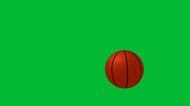 Basketball falling on green chroma key background Basketball jumping over a chroma key background basketball stock videos & royalty-free footage