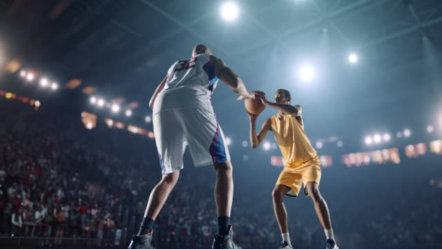 Basketball game moment Basketball game moment on a professional arena which is made in 3D. basketball stock videos & royalty-free footage