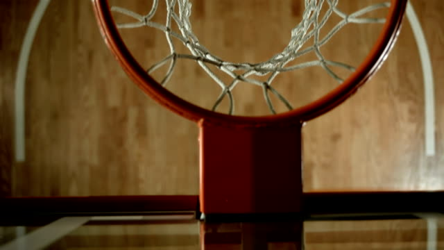 HD SLOW MOTION: Basketball Going Through A Hoop video