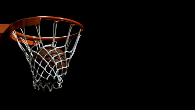 stockvideo's en b-roll-footage met basketball going through a hoop (super slow motion) - basketbal teamsport