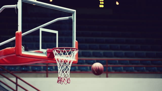 Basketball into hoop, slow motion Basketball into hoop, slow motion scoring a goal stock videos & royalty-free footage