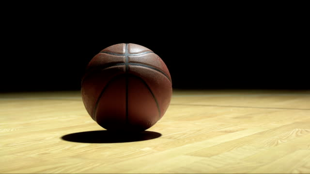 stockvideo's en b-roll-footage met basketball laying on the floor - basketbal teamsport