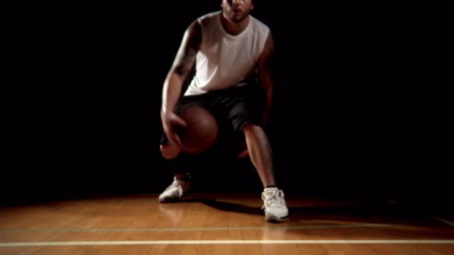 Basketball player dribbles toward the Camera video