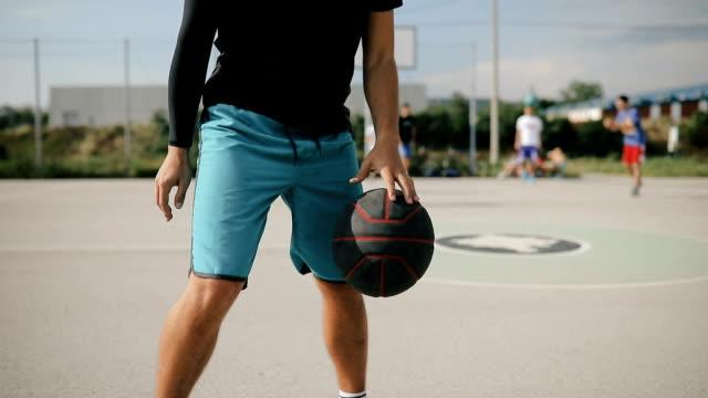 Basketball player exercising on basketball court.