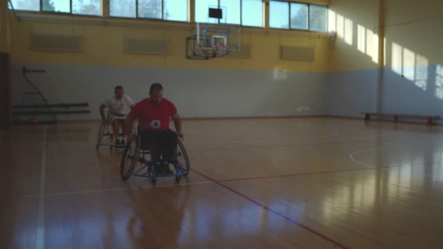 Basketball player in wheelchair riding