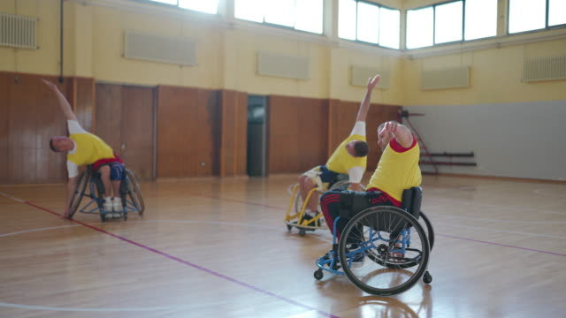 Basketball player in wheelchair stretching
