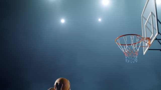Basketball player makes a slam dunk