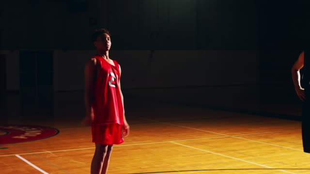 A basketball player shooting a free throw, misses and tries again, slow motion video