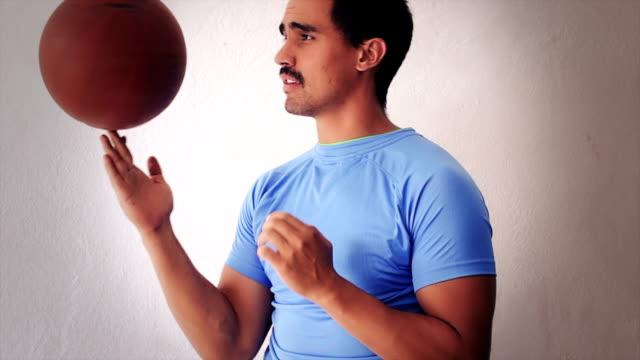 Basketball player spinning a ball video