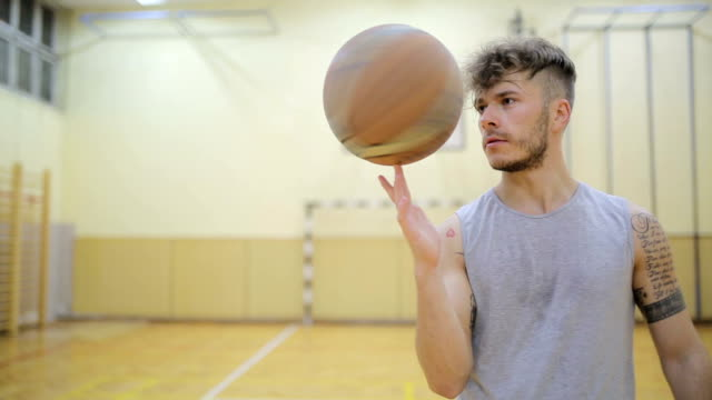 Basketball player spinning a ball