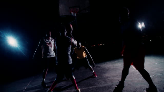 Basketball Players Playing in Court During Nighttime video
