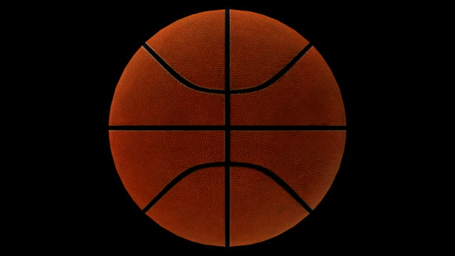 Basketball rotating loop isolated with luma matte video