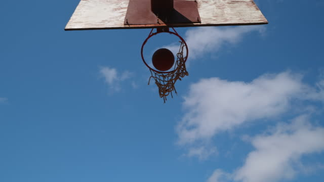 Basketball Throw Through The Basketball Hoop Africa, Sports, Basketball - Low Angle 4K Footage of a Basketball Hoop. chance stock videos & royalty-free footage