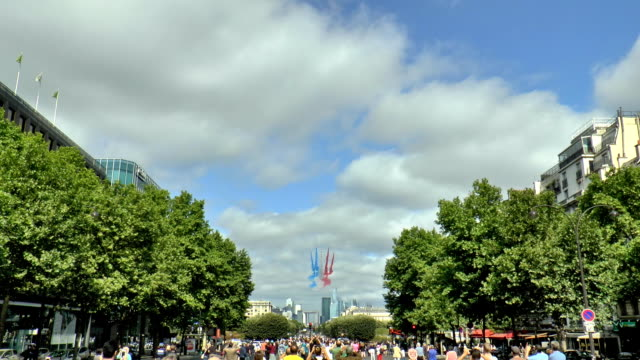 Bastille Day Flyover - Paris, France The French Air Force flyover streaming blue, white and red smoke marking the start of the Bastille Day parade down the Avenue des Champs-Elysées in Paris, France. Filmed with a Panasonic HD-X920 camcorder in HD1080. bastille day stock videos & royalty-free footage