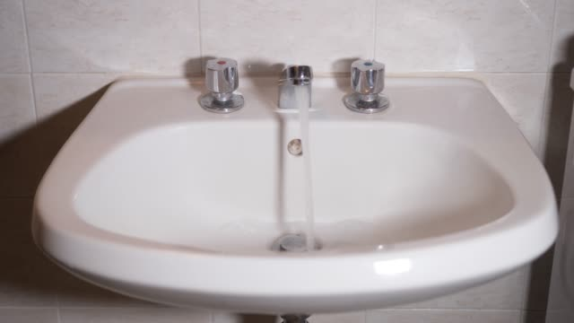 Bathroom faucet opens and lets water out