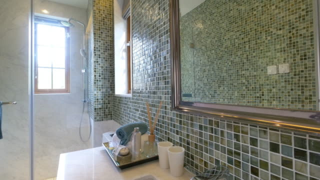 bathroom interior with big mirror video