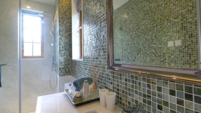 bathroom interior with big mirror video
