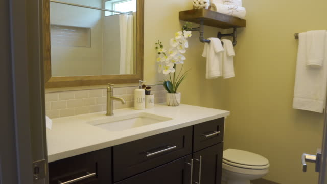 Bathroom Move Right at Doorway view moves right on detail shot of bathroom sink and toilet bathroom stock videos & royalty-free footage