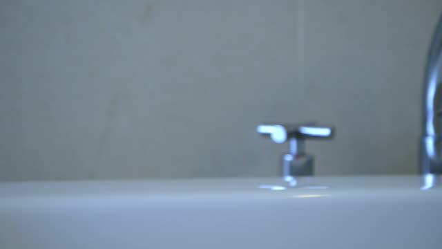 Bathtub faucet in the bathroom Bathtub faucet in the bathroom handle stock videos & royalty-free footage