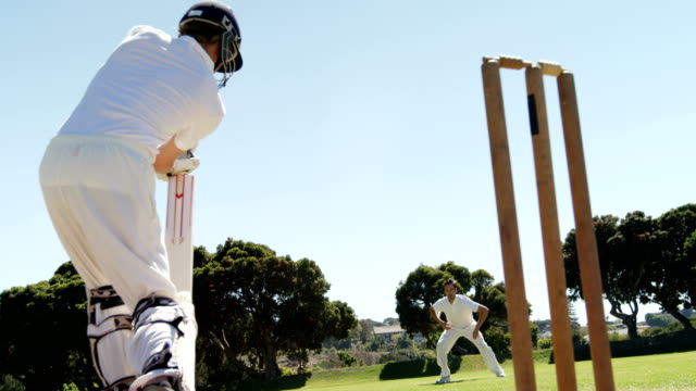 Batsman playing a defensive stroke during cricket match video