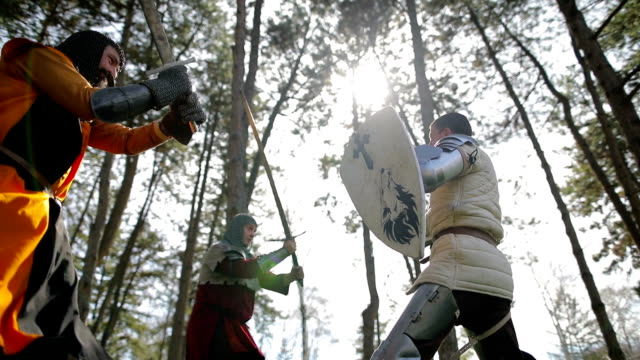 Battle between three aggressive and strong opponents, medieval knights. Battle between three aggressive and strong opponents, medieval knights. knight person stock videos & royalty-free footage