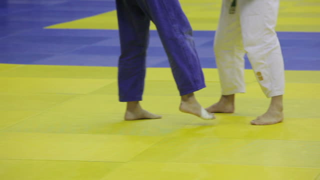 Battle of two fighters judo. Only their legs video