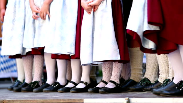 Bavarian folk dance group with children is waiting video