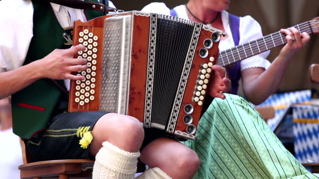 bavarian musician at oktoberfest in munich - oktoberfest stock videos and b-roll footage
