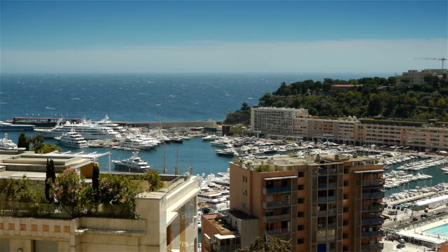Bay and harbor at Monaco, Cote D'Azur France An urban video shot of the wealthy city Monaco. A famous luxury cityscape at the Cote D'Azur in the south of France.  The port of Monaco with luxury yachts. monte carlo stock videos & royalty-free footage