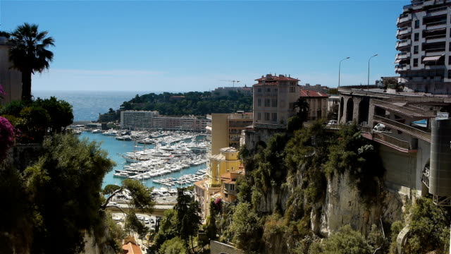 Bay of Monaco, Cote D'Azur France A scenic video shot of the wealthy city Monaco. A famous luxury cityscape at the Cote D'Azur in the south of France. monte carlo stock videos & royalty-free footage
