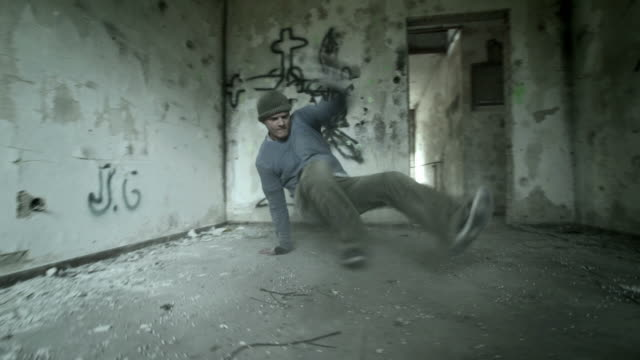 HD: B-Boy Performing Power Moves In Obsolete Building video