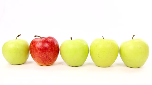 be different chooses red apple from line with green apples video
