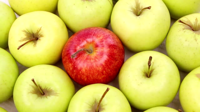 be different - green apples with one red apple video