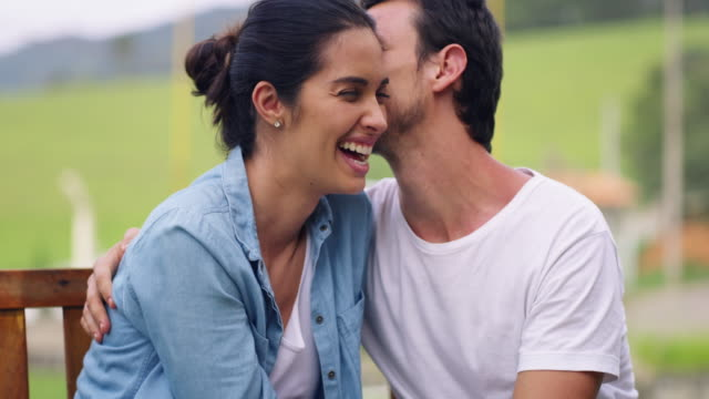 Be each other's reason to smile 4k video footage of a young couple sharing a romantic moment on a park bench falling in love stock videos & royalty-free footage