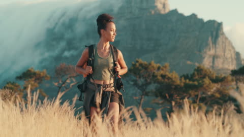 Be up for new adventures 4k video footage of a young woman out on a hike through the mountains footpath stock videos & royalty-free footage