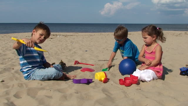 Beach activity. Children playing on the seaside. video