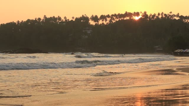 Beach and sea wave at Mirissa during sunset, Sri Lanka Tropical sand beach and sea water wave at Mirissa during sunset, Sri Lanka colombo stock videos & royalty-free footage