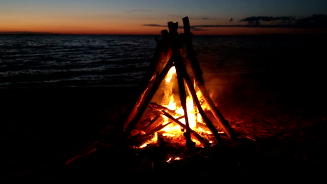 beach bonfire at sunset video