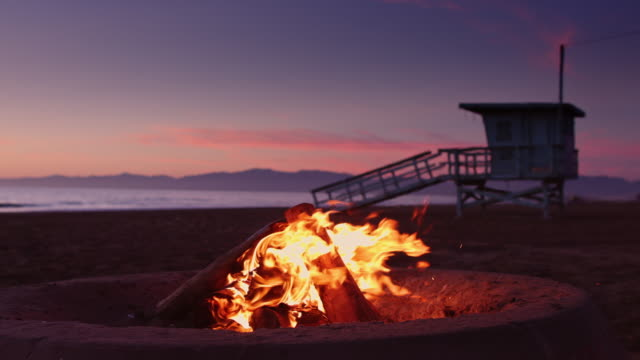 Beach Bonfire with Lifeguard Hut and Breaking Waves - video