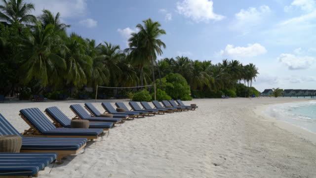 beach chair with tropical beach and sea in Maldives