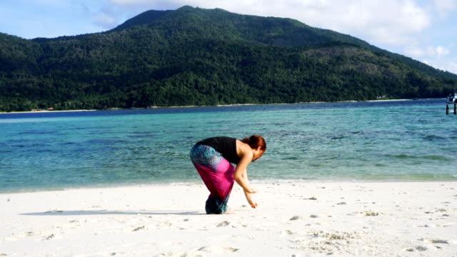 Beach holiday. Woman having picking seashells