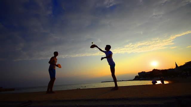 Beach laisure tennis game video