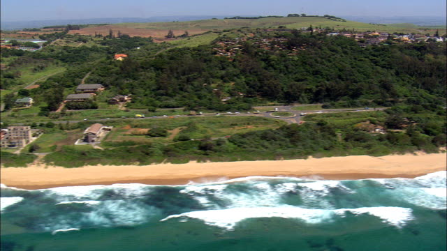 Beach near Desainagar - Aerial View - KwaZulu-Natal,  eThekwini Metropolitan Municipality,  Ethekwini,  South Africa This clip was filmed by Skyworks on HDCAM SR 4:4:4 using the Cineflex gimbal. KwaZulu-Natal,  eThekwini Metropolitan Municipality,  Ethekwini South Africa natal stock videos & royalty-free footage