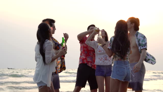 Beach party, group of young people celebrating in weekend