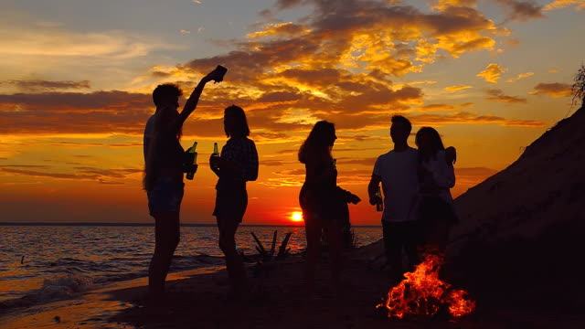 Beach party, selfie. Slow-motion silhouette shooting. video